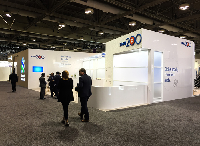 A view of the BMO SIBOS activation, with a view of the custom designed curved wall, the meeting area and the media player